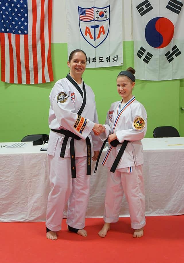 4Kicks Family Taekwondo student getting an award