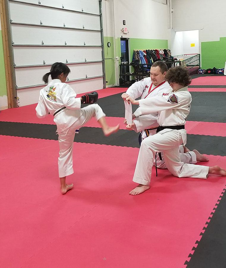 4Kicks Family Taekwondo kid breaking board